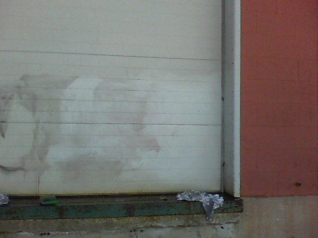 Graffiti removal from over-head doors